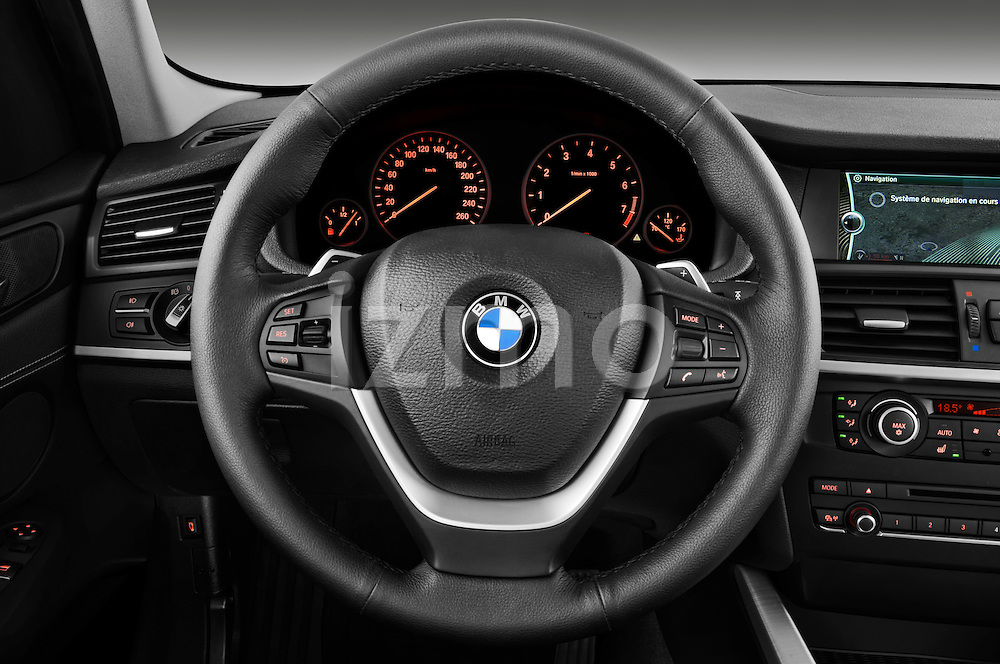 Steering wheel view of a 2011 BMW x3 xDrive35i SUV
