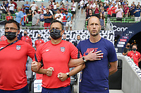 AUSTIN, TX - JULY 29: United States head coach Gregg Berhalter during the playing of the national anthem during a game between Qatar and USMNT at Q2 Stadium on July 29, 2021 in Austin, Texas.