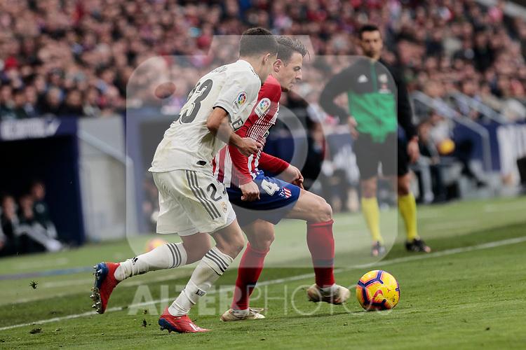 Atletico de Madrid's Santiago Arias and Real Madrid's Sergio Reguilon during La Liga match between Atletico de Madrid and Real Madrid at Wanda Metropolitano Stadium in Madrid, Spain. February 09, 2019. (ALTERPHOTOS/A. Perez Meca)