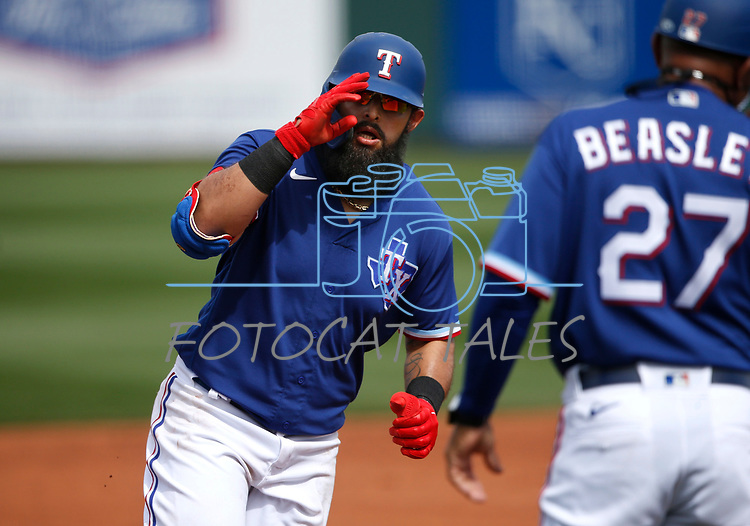 Rougned Odor rounds third after hitting a home run during a spring training game between the Texas Rangers and Los Angeles Dodgers in Surprise, Ariz., on Sunday, March 7, 2021.<br /> Photo by Cathleen Allison