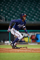 Mississippi Braves second baseman Travis Demeritte (11) runs to first base during a game against the Montgomery Biscuits on April 24, 2017 at Montgomery Riverwalk Stadium in Montgomery, Alabama.  Montgomery defeated Mississippi 3-2.  (Mike Janes/Four Seam Images)