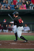 Great Falls Voyagers left fielder Alex Destino (24) follows through on his swing during a Pioneer League game against the Idaho Falls Chukars at Melaleuca Field on August 18, 2018 in Idaho Falls, Idaho. The Idaho Falls Chukars defeated the Great Falls Voyagers by a score of 6-5. (Zachary Lucy/Four Seam Images)