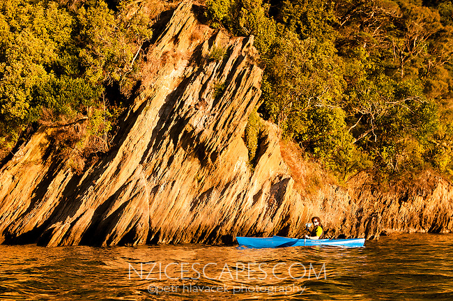 Kayaker in Ngakuta Bay in Marlborough Sounds - Marlborough, New Zealand