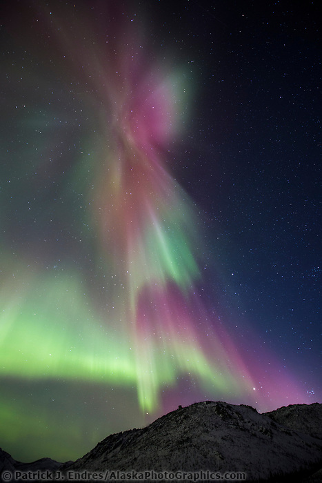 The northern lights burst into a colorful display during a night of high aurora activity in the White Mountains Recreation Area in Alaska's interior. March 17, 2013. Aurora corona as seen when standing directly below a bundle of parallel plasma-channeling magnetic field lines that are converging on a point high in the sky.