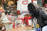 2005, Montreal Qc) CANADA<br /> Model Released photo<br /> a black woman look at the window display of a tourist shop in  Old-Montreal, Canada<br /> Photo : (c) 2005 Pierre Roussel