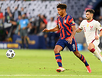 AUSTIN, TX - JULY 29: Nicholas Gioacchini #8 of the United States chases after a loose ball with Bassam Al Rawi #15 of Qatar right behind him during a game between Qatar and USMNT at Q2 Stadium on July 29, 2021 in Austin, Texas.