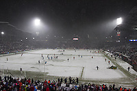 Staff members attempt to clear snow off the field at Dick's Sporting Good Park in Commerce City, CO before the USA Men's National Team's World Cup Qualifier against Costa Rica on March 22, 2013.