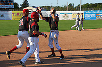 Batavia Muckdogs Walker Olis (3) high fives Aneury Osoria (16) and Eric Gutierrez (43) after a walk off hit during the second game of a doubleheader against the Auburn Doubledays on September 4, 2016 at Dwyer Stadium in Batavia, New York.  Batavia defeated Auburn 6-5. (Mike Janes/Four Seam Images)