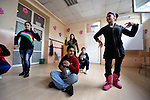 Bajram Kruezi (center) plays a drum as other students dance to traditional Roma music in the Branko Pesic School, an educational center for Roma children and families in Belgrade, Serbia, which is supported by Church World Service. Kruezi's family came to Belgrade as refugees from Kosovo, and like many Roma can't afford regular school fees. Many Roma also lack legal status in Serbia, and thus have difficulty obtaining formal employment and accessing government services.