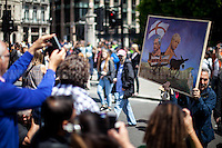 """Kaya Mar (Painter and political caricaturist - For more information about the Artist please click here:  http://www.kayamarart.com/ ).<br /> <br /> London, 02/07/2016. Today, more than 60 thousand people marched peacefully from Park Lane to Parliament Square to protest against the EU Referendum result which is leading the United Kingdom to the so called """"Brexit"""", in other words to leave the European Union. Protestors of all ages were present in significant numbers representing all the generations of the British population. On the 23rd of June 2016 the British people voted in the EU Referendum (Turnout 72.2%): 51,9% to leave the EU (17,410,742 Votes) versus 48,1% to remain in the EU (16,141,241 Votes). In the morning of the 24th of June the British Prime Minister David Cameron gave a speech outside 10 Downing Street in which he announced the EU Referendum results and his formal resignation within 3 months. Cameron decision triggered the leadership race in the Conservative Party between the Home Secretary Theresa May MP (backed Remain in the EU Referendum) and the Lord Chancellor and Secretary of State for Justice Michael Gove MP (backed Leave in the EU Referendum). On the 30th of June, the former Mayor of London and major figure in the Leave Campaign, Boris Johnson MP, surprisingly withdrew from the leadership contest. The new leader of the Conservative Party will succeed David Cameron as the new British Prime Minister.<br /> <br /> For more information about the demo please click here: https://www.facebook.com/events/1732671000335981/ & https://www.facebook.com/events/244646665920554/<br /> <br /> For more information about the result please click here: http://www.bbc.co.uk/news/politics/eu_referendum/results"""