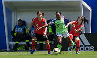 GRENOBLE, FRANCE - JUNE 12: Selgi Jang #16 of the Korean National Team, Francisca Ordega #17 of the Nigerian National Team, and Mina Lee #7 of the Korean National Team battle for the ball during a game between Korea Republic and Nigeria at Stade des Alpes on June 12, 2019 in Grenoble, France.