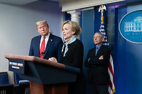 President Donald J. Trump looks on as White House Coronavirus Response Coordinator Dr. Deborah Birx delivers remarks during a coronavirus update briefing Tuesday, March 24, 2020, in the James S. Brady Press Briefing Room of the White House.<br /> <br /> People: President Donald J. Trump, Dr. Deborah Birx