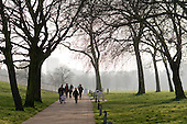 A family jogging in Regents Park, London