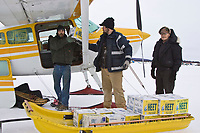 Volunteers load a plane witih *HEET* & supplies at McGrath on Friday during the 2008 Iditarod