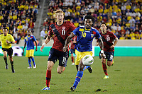 Gabriel Achilier (18) of Ecuador is chased by Brek Shea (11) of the United States. The men's national team of the United States (USA) was defeated by Ecuador (ECU) 1-0 during an international friendly at Red Bull Arena in Harrison, NJ, on October 11, 2011.
