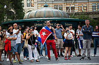 NEW YORK, NEW YORK - JULY 14: A man with the Cuban flag accompanies Cuban protesters in Union Square Park on July 14, 2021 in New York City. A small group of people gathered in Union Square Park in support of the Cuban people who have been protesting against the communist regime due to food shortages and the worsening of the economic crisis that has been exasperated by the coronavirus pandemic (COVID-19) . The protest on the island has been the largest protest against the government in decades. (Photo by Pablo Monsalve / VIEWpress via Getty Images)