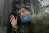 """Kristina <br /><br />Portraitserie von Obdachlosen in Kiew während der Corona Pandemie. Der Fotograf hat sie gebeten sich hinter dem Glas der Bahnhöfe fotografieren zu lassen. Er sagt: Ich porträtierte die Obdachlosen hinter dem Glas der Haltestellen und Unterführungen - das sind die Orte, an denen sie übernachten und leben. Das Glas ist aber auch symbolisch wie eine Wand zwischen uns und ihnen - wir sehen sie, aber wir hören sie nicht, sie sind wie Fische in Aquarien - isoliert von der Gesellschaft. Es ist nicht möglich, durch das Glas eine helfende Hand zu erreichen. Wir sympathisieren mit ihnen, wenn wir Ihnen während der Quarantäne von unseren Fenstern aus zuschauen, aber wir sind durch unsere komfortablen Wohnungen geschützt und sie blicken von unten zu unseren Fenstern hoch. / Portrait series of homeless people in Kiev during the Corona Pandemic. The photographer asked them to be photographed behind the glass of the train stations. He says: """"I portrayed the homeless behind the glass of the stations and underpasses - these are the places where they stay and live. But the glass is also symbolic like a wall between us and them - we see them but we don't hear them, they are like fish in aquariums - isolated from society. It is not possible to reach a helping hand through the glass. We sympathize with them when we watch them from our windows during quarantine, but we are protected by our comfortable apartments and they look up to our windows from below."""