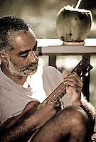 Island man playing ukulele.