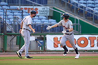 Lakeland Flying Tigers manager Andrew Graham (12) congratulates Jimmy Kerr (8) after hitting a home run during a game against the Clearwater Threshers on May 5, 2021 at BayCare Ballpark in Clearwater, Florida.  (Mike Janes/Four Seam Images)