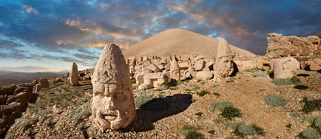 Statue head at sunset, from left, Antiochus, Commenge , Zeus, Apollo, Herekles & Eagle, in front of the 62 BC Royal Tomb of King Antiochus I Theos of Commagene, west Terrace, Mount Nemrut or Nemrud Dagi summit, near Adıyaman, Turkey