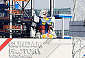 A 18-meter tall rob ot Gundam from a TV animation stands in Yokohama