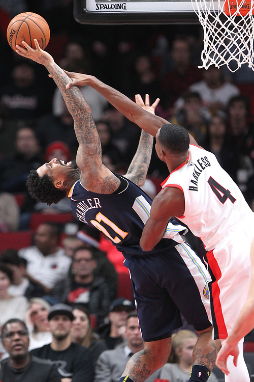 Portland Trail Blazers forward Maurice Harkless (4) contests the shot from Denver Nuggets forward Wilson Chandler (21) in the second half at Moda Center.