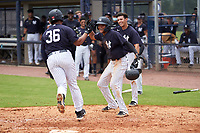 FCL Yankees Jose Martinez (36) high fives Dionys Vallejo (41) after hitting a home run during a game against the FCL Phillies on July 6, 2021 at the Yankees Minor League Complex in Tampa, Florida.  (Mike Janes/Four Seam Images)