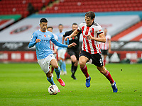 31st October 2020; Bramall Lane, Sheffield, Yorkshire, England; English Premier League Football, Sheffield United versus Manchester City; Sander Berge of Sheffield United and Joao Cancelo of Manchester City chase a loose ball