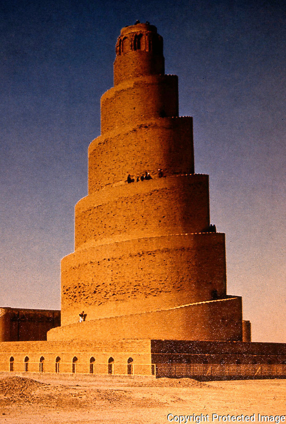 """World Civilization:  Islamic Architecture--Samarra, Iraq. Minaret of the Great Mosque of Al-Muta-Whakil, also known as """"The Spiral"""". 165 feet high and 90 feet from the Mosque's north side. There was a viaduct connecting the wall and the minaret."""