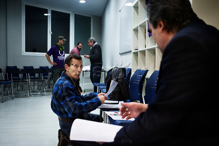 Madrid, Spain, February 12, 2015. A member of the left wing [party] Podemos prepares a speech before to take part in their weekly meeting in Salamanca's neighbourhood in Madrid.