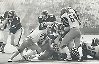 1979 FILE PHOTO - ARCHIVES -<br /> <br /> Doesn't shy away: Tiger-Cats' general manager Ralph Sazio is impressed with the play of linebacker Ben Zambiasi (31). Sazio says the Georgia product has great quickness and speed as well as being tough. Says Sazio: He doesn't shy away from tackles.<br /> <br /> Bezant, Graham<br /> Picture, 1979<br /> <br /> 1979,<br /> <br /> PHOTO : Graham Bezant - Toronto Star Archives - AQP