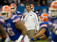 01 January 2010:  Florida head coach Urban Meyer watches his team during warm-ups before the game against Cincinnati during Sugar Bowl at the SuperDome in New Orleans, Louisiana.