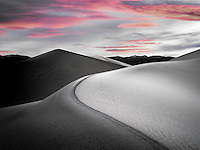 Sand dunes and sunrise in Death Valley National Park, California. Sky was added