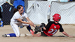 Colorado Northwestern's Lola Williams slides safely under Western Nevada's Heather Septon tag during a college softball game in Carson City, Nev., on Friday, Feb. 22, 2013..Photo by Cathleen Allison/Nevada Photo Source
