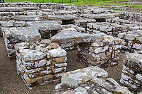 Northumberland, England, UK.  Chesters (Cilurnum) Roman Fort.  Pillars at the Commander's House Support Stone Floors to Allow Warm Air to Flow Underneath.