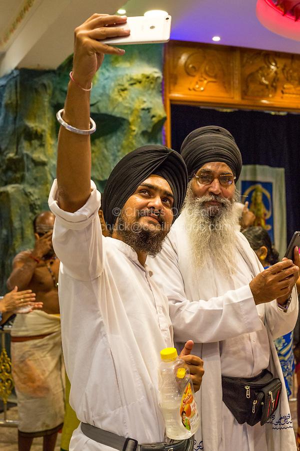 Batu Caves, Sikh Visitors Taking a Selfie, Selangor, Malaysia.