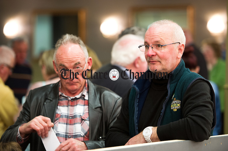 Sinn Fein's Mike Mc Kee, right, during the election count at The West county Hotel, Ennis. Photograph by John Kelly.