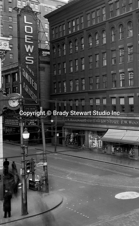 Pittsburgh PA:  View of the FW Woolworth Building and Loew's Movie Theater at the corner of Sixth Street and Liberty Ave. Born To Dance was playing at the movies and local boy Jimmy Stewart was a headliner.