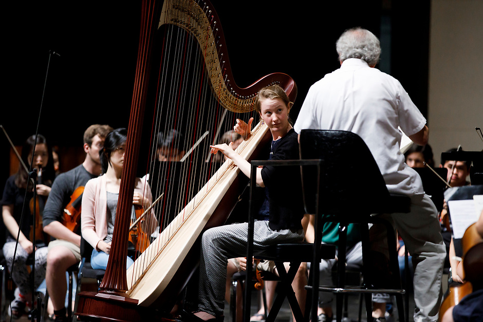 Mathilde Wauters from Belgium speaks with conductor Arthur Fagen during an orchestra rehearsal for the Final Stage concert at the 11th USA International Harp Competition at Indiana University in Bloomington, Indiana on Friday, July 12, 2019. (Photo by James Brosher)