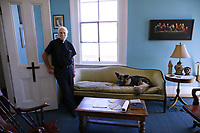 Father Bill Terry of St. Anna's Episcopal Church poses for a photograph at his office in New Orleans, La., Tuesday, March 20, 2018.
