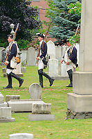 Soldiers of the Sixth Connecticut Regiment, Company of Light Infantry, of the Continental Army, march to the grave of Roger Sherman during July 4th ceremony to recognize fallen patriots in the War of Independence at Grove Street Cemetery, New Haven, Connecticut, USA.