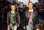 Punk fashion Kings Road Chelsea London UK Teens making a fashion statement, studded jackets, punk hairstyle,  home bleached out jeans. 1980s 80s