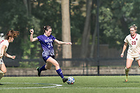 NEWTON, MA - SEPTEMBER 12: Cerys Balmer #24 of Holy Cross passes the ball during a game between Holy Cross and Boston College at Newton Campus Soccer Field on September 12, 2021 in Newton, Massachusetts.