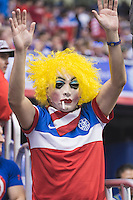 A United States' soccer fan cheers during an international friendly at the Alamodome, Wednesday, April 15, 2015 in San Antonio, Tex. USA defeated Mexico 2-0. (Mo Khursheed/TFV Media via AP Images)