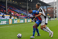 Patrick van Aanholt of Crystal Palace battles with Bobby Reid of Fulham during the Premier League behind closed doors match between Crystal Palace and Fulham at Selhurst Park, London, England on 28 February 2021. Photo by Vince Mignott / PRiME Media Images.