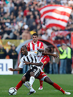 Almami da Silva Moreira of Partizan Belgrade, left, fight for the ball with Red Star player Awal Issah, right, during the Serbian League soccer match in Belgrade, Serbia, Saturday, October  24, 2010. (Srdjan Stevanovic/Starsportphoto.com)