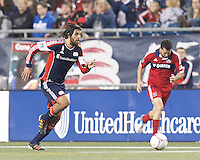 New England Revolution substitute midfielder Juan Toja (18) brings the ball forward. In a Major League Soccer (MLS) match, the New England Revolution (blue) defeated Chicago Fire (red), 1-0, at Gillette Stadium on October 20, 2012.