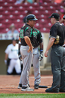 Dayton Dragons manager Dick Schofield (22) questions a call with umpire Cody Stashak during a game against the Cedar Rapids Kernels on July 24, 2016 at Perfect Game Field in Cedar Rapids, Iowa.  Cedar Rapids defeated Dayton 10-6.  (Mike Janes/Four Seam Images)