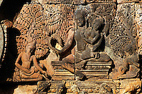 Banteay Srei with bas relief in red sandstone of the Hindu Gods Shiva & Parvati, 10th century Khmer architecture at Angkor Wat -  Siem Reap, Cambodia...