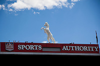 Bronco statue and Sports Authority sign over entrance seen from inside Mile High Stadium.